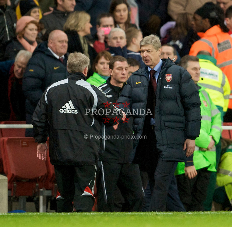 LONDON, ENGLAND - Sunday, December 21, 2008: Liverpool's assistant manager Sammy Lee and Arsenal's manager Arsene Wenger during the Premiership match at the Emirates Stadium. (Photo by David Rawcliffe/Propaganda)