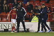 Nottingham Forest manager Paul Williams  consoles Nottingham Forest forward Jamie Ward (19) as he is substituted with an injury during the Sky Bet Championship match between Nottingham Forest and Brighton and Hove Albion at the City Ground, Nottingham, England on 11 April 2016. Photo by Simon Davies.