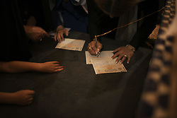 May 18, 2017 - Yazd, Iran - Iranians fill their voting papers before they cast their ballots at a polling station during Iran's 12th presidential election, in Yazd, which is one of the main cities of Iran on May 19, 2017. (Credit Image: © Marjan Yazdi/NurPhoto via ZUMA Press)