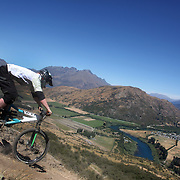 Troy Murdoch, Queenstown, in action during the New Zealand South Island Downhill Cup Mountain Bike series held on The Remarkables face with a stunning backdrop of the Wakatipu Basin. 150 riders took part in the two day event. Queenstown, Otago, New Zealand. 9th January 2012. Photo Tim Clayton