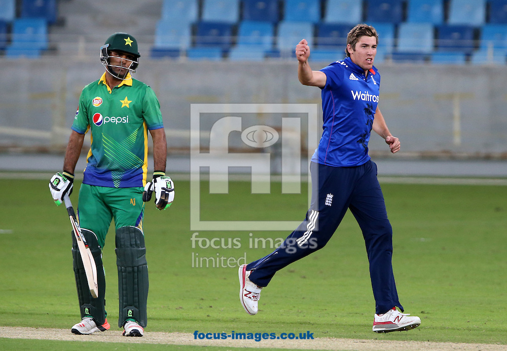 Jamie Overton of England Lions takes the wicket of Fakhar Zaman of Pakistan A (L) during the International Twenty/20 match at Dubai International Cricket Stadium, Dubai<br /> Picture by Chris Whiteoak-Medcalf/Focus Images Ltd +971 8117530<br /> 10/12/2015