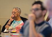 Architects, Houston ISD staff and PAT members discuss design options for Madison High School during a Jordan and Madison High School design charrette at the Houston Food Bank, May 29, 2015.