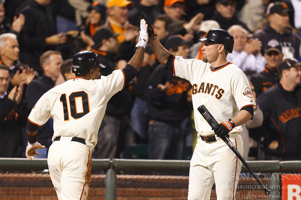 May 11, 2011; San Francisco, CA, USA;  San Francisco Giants shortstop Miguel Tejada (10) is congratulated by first baseman Aubrey Huff (17) after scoring a run against the Arizona Diamondbacks during the sixth inning at AT&T Park.