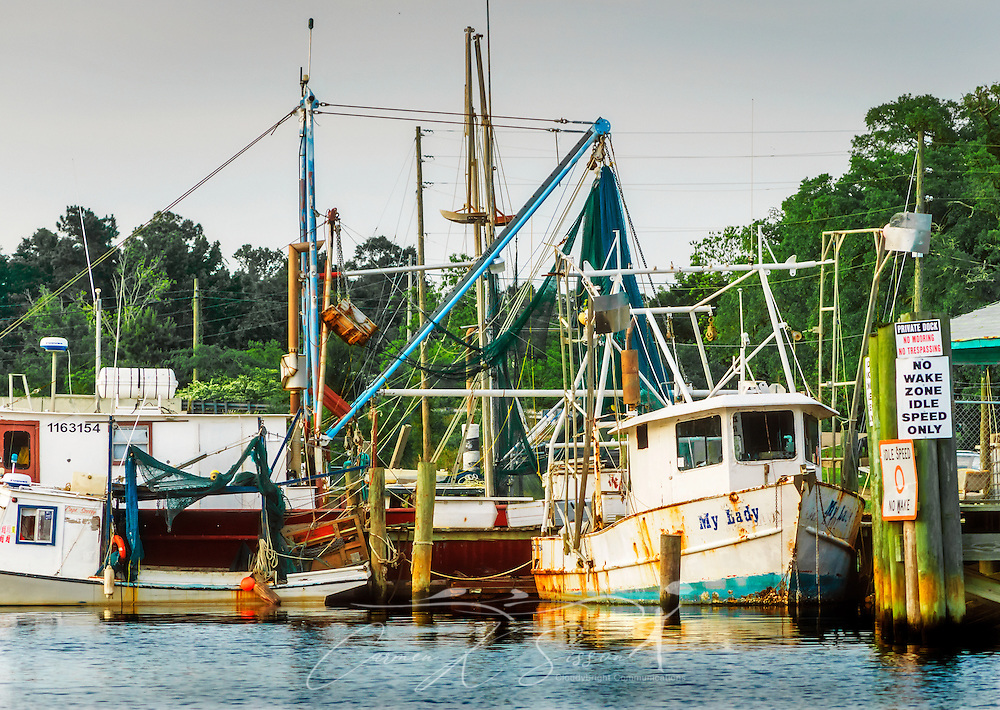"""The sun sets on the """"My Lady"""" and other shrimp boats, May 2, 2014, in Bayou La Batre, Alabama. (Photo by Carmen K. Sisson/Cloudybright)"""