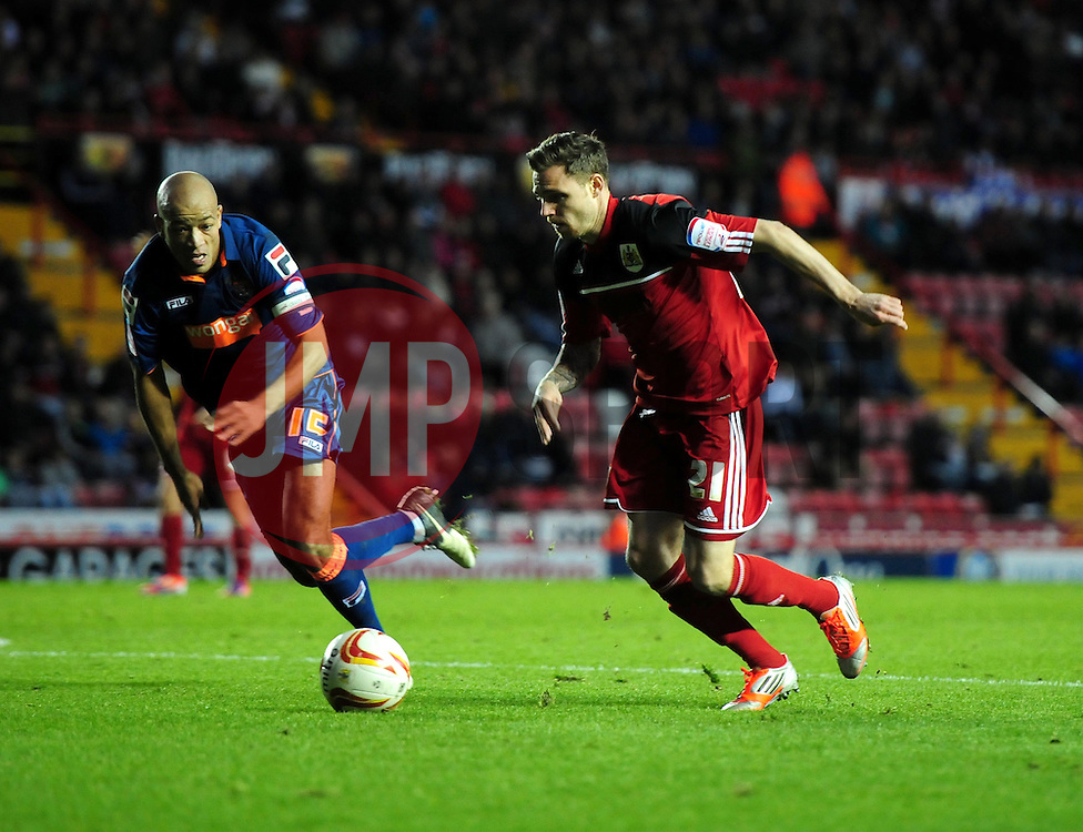 Bristol City's Paul Anderson takes the ball past Blackpool's Alex John-Baptiste - Photo mandatory by-line: Joe Meredith/JMP  - Tel: Mobile:07966 386802 17/11/2012 - Bristol City v Blackpool - SPORT - FOOTBALL - Championship -  Bristol  - Ashton Gate Stadium -