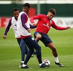 England's Alex Oxlade-Chamberlain challenges Marcus Rashford - Mandatory by-line: Matt McNulty/JMP - 29/08/2017 - FOOTBALL - St George's Park National Football Centre - Burton-upon-Trent, England - England Training and Press Conference