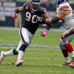 October 10, 2010; Houston, TX USA; Houston Texans defensive end Mario Williams (90) rushes against New York Giants offensive tackle David Diehl (66)during the first half at Reliant Stadium. Mandatory Credit: Derick E. Hingle