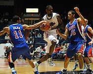 """Ole Miss' Terrance Henry (1) vs. SMU's London Giles (11) and SMU's Cannen Cunningham (15) at the C.M. """"Tad"""" Smith Coliseum in Oxford, Miss. on Tuesday, January 3, 2012. Ole Miss won 50-48."""