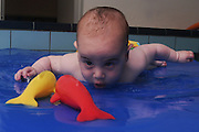 Baby boy of 6 months in a swimming pool Model Release Available