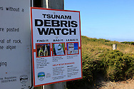 A Tsunami Debris watch sign on the Colquille River Lighthouse park on the Oregan coast.  Photo by Dennis Brack...