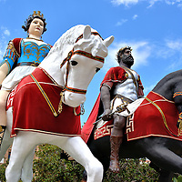Giants Mata and Grifone in Messina, Italy<br /> These huge equestrian statues wearing cloth costumes stand between the Palazzo Zanca (city hall) and the harbor.  They are the giants of Mata and Grifone (the male soldier), the legendary founders of Messina. Several times a year during religious festivals and especially in mid-August for the multi-day celebration of the Assumption of the Virgin Mary, they are part of citywide processions. The oldest version of these papier m&acirc;ch&eacute; statues dates back to 1723.