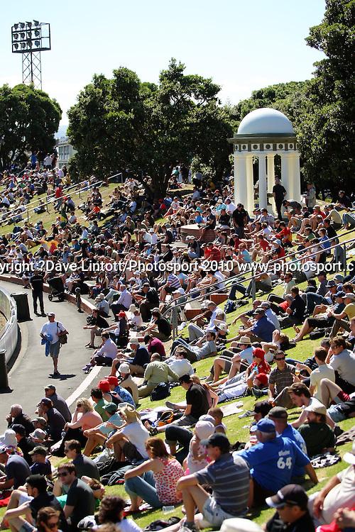 Fans enjoy the sunshine on the embankment.<br /> 1st cricket test match - New Zealand Black Caps v Australia, day one at the Basin Reserve, Wellington.Friday, 19 March 2010. Photo: Dave Lintott/PHOTOSPORT