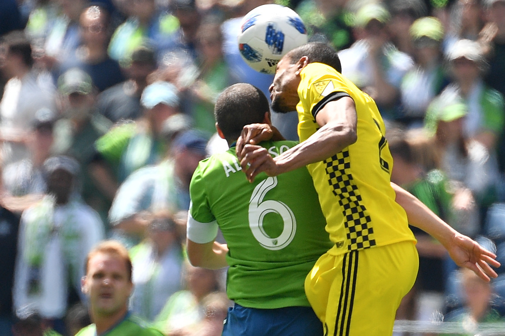 May 05, 2018; Seattle, Washington, US;  Seattle Sounders midfielder Osvaldo Alonso (6) fights for a header during in action between the Seattle Sounders FC and Columbus Crew at Century Link Field. Photo credit: Rick May - Rick May Photography
