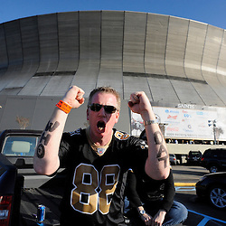 Jan 24, 2010; New Orleans, LA, USA; A New Orleans Saints fan tailgates outside prior to kickoff of the 2010 NFC Championship game at the Louisiana Superdome. Mandatory Credit: Derick E. Hingle