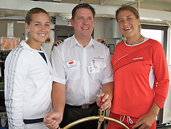 Liverpool, England - Sunday, June 10, 2007: Acting captain Robbie Quinn shows Ashley Harkleroad (L) and Olga Savchuk (R) how to steer the Mersey Ferry the Royal Daffodul during a cruise along Liverpool's famous River Mersey. The WTA tennis players are in the city for the Liverpool International Tennis Tournament which starts on Tuesday June 12th. For more information please visit www.liverpooltennis.co.uk. (Pic by David Rawcliffe/Propaganda)