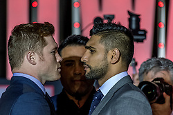 "LOS ANGELES, CA - MARCH 2: WBC, Ring Magazine and Lineal Middleweight World Champion Canelo Alvarez (46-1-1, 32 KOs) and  former two-time world champion and resurgent contender Amir ""King"" Khan (31-3, 19 KOs) faceoff during Canelo vs Khan press conference at Universal CityWalk - Five Towers Stage on March 2, 2016 in Los Angeles. Canelo vs. Khan, a 12-round fight for Canelo's WBC, Ring Magazine and Lineal Middleweight World Championships, is promoted by Golden Boy Promotions in association with Canelo Promotions and sponsored by Cerveza Tecate, BORN BOLD, O'Reilly Auto Parts and Casa Mexico Tequila. The mega-event will take place on Saturday, May 7 at T-Mobile Arena in Las Vegas and will be produced and distributed live by HBO Pay-Per-View beginning at 9:00 p.m. ET/6:00 p.m. PT. Byline, credit, TV usage, web usage or linkback must read SILVEXPHOTO.COM. Failure to byline correctly will incur double the agreed fee. Tel: +1 714 504 6870."