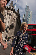 Pedestrians walk along Bishopsgate on 12th September, in the City of London, UK.