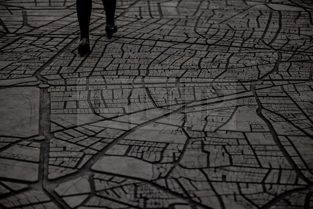 © Licensed to London News Pictures. 14/06/2016. London, UK. A woman walks across a large rubber street map of Beirut installed in the Switch House, the new Tate Modern building which opens to the public on Friday 17 June 2016. The ten-storey extension was designed by architects Herzog & de Meuron and includes the world's first gallery space dedicated exclusively to live art, film and installations. Photo credit: Rob Pinney/LNP