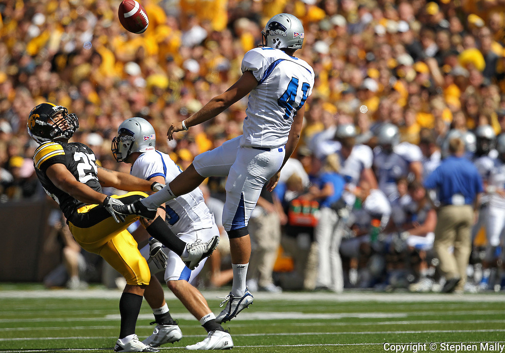 September 4 2010: Iowa Hawkeyes' Paki O'Meara (25) blocks a punt by Eastern Illinois Panthers punter Kevin Cook (41) and runs it back for a touchdown during the first quarter of the NCAA football game between the Eastern Illinois Panthers and the Iowa Hawkeyes at Kinnick Stadium in Iowa City, Iowa on Saturday September 4, 2010. Iowa defeated Eastern Illinois 37-7.