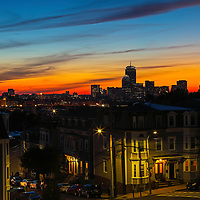 South Boston sunset view of Boston skyline showing parts of the Dorchester Heights neighborhood and the Beantown Hub in the backdrop.   <br />