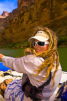 River guide Amanda LaRiche rowing, Whitewater rafting trip (oar trip) on the Colorado River in Grand Canyon, Grand Canyon National Park, Arizona USA