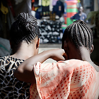 Arusha, Tanzania 01 November 2010<br /> Two Tanzanian women buy goods at a market in Arusha, on the day after the Presidential Elections.<br /> The European Union has launched an Election Observation Mission in Tanzania to monitor the general elections, responding to the Tanzanian government invitation to send observers for all aspects of the electoral process.<br /> The EU sent this observation mission led by Chief Observer David Martin, a member of the European Parliament. <br /> PHOTO: EZEQUIEL SCAGNETTI