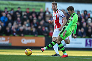 Forest Green Rovers Christian Doidge(9) shoots at goal scores a goal 1-0 during the EFL Sky Bet League 2 match between Forest Green Rovers and Cheltenham Town at the New Lawn, Forest Green, United Kingdom on 25 November 2017. Photo by Shane Healey.