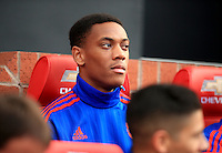 Manchester United's Anthony Martial sits in the dugout