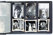 photo album page with family and wedding images 1950s England