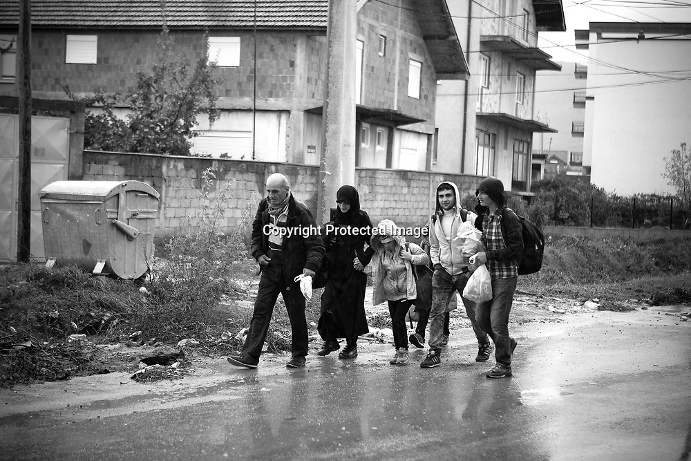 In a raining day Syrian refugees arriving in Presevo, Serbia. They just crossed the border from Macedonia and they are going to register before they can catch the bus to the next stop in Sid - a small town in the border with Croatia.