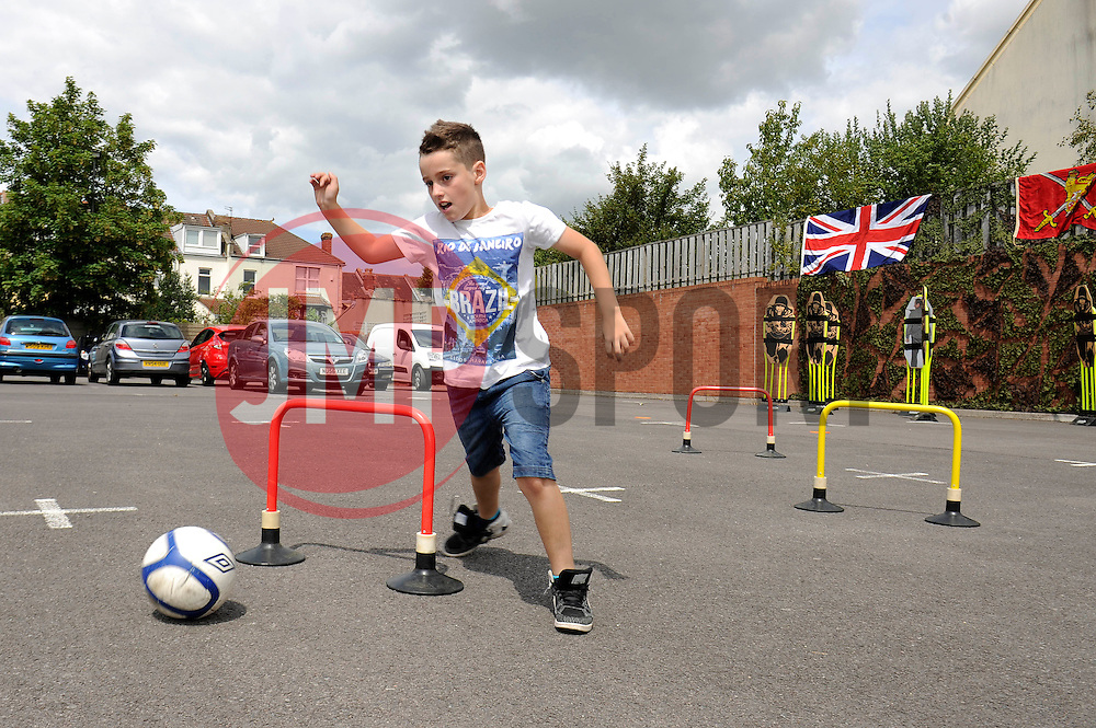 Army Football challenge at the Bristol Rovers Fun Day - Photo mandatory by-line: Dougie Allward/JMP - Mobile: 07966 386802 27/07/2014 - SPORT - FOOTBALL - Bristol - Bristol Rovers - - Memorial Stadium - Fun Day