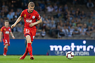 Adelaide United defender Jordan Elsey (23) passes the ball at the Hyundai A-League Round 7 soccer match between Melbourne Victory v Adelaide United at Marvel Stadium in Melbourne, Australia.