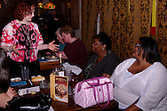 """Tamra Francis (left) during Mayhem & Mystery's production of """"Fashion Friction"""" at the Spaghetti Warehouse in downtown Dayton, Monday, March 21, 2011."""
