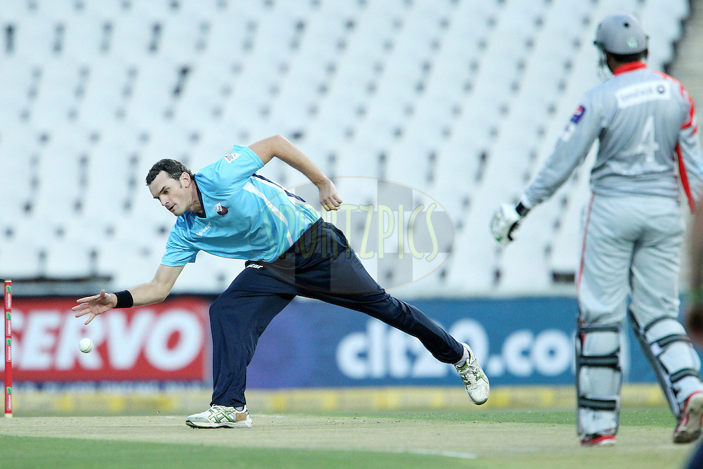 Kyle Mills fields from his own bowling during 2nd Qualifying match of the Karbonn Smart CLT20 South Africa between Auckland Aces and Sialkot Stallions held at The Wanderers Stadium in Johannesburg, South Africa on the 9th October 2012..Photo by Ron Gaunt/SPORTZPICS/CLT20