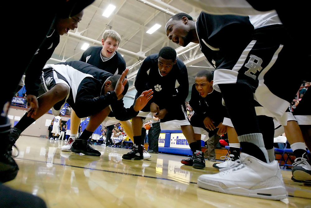 Herald &amp; Review/Stephen Haas<br /> The Eisenhower team goes through their pre-game rituals on the court at the start of a game at MacArthur High School in Decatur, Ill., Friday, Feb. 15, 2008.