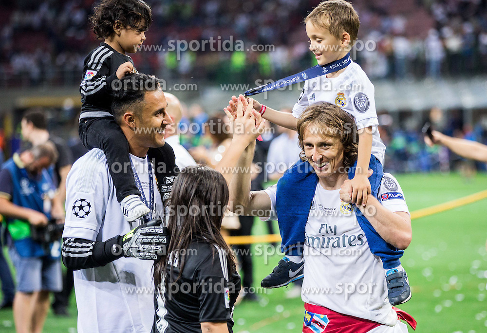 Keylor Navas of Real Madrid and Luka Modrić of Real Madrid with their children celebrate after winning during football match between Real Madrid (ESP) and Atlético de Madrid (ESP) in Final of UEFA Champions League 2016, on May 28, 2016 in San Siro Stadium, Milan, Italy. Photo by Vid Ponikvar / Sportida