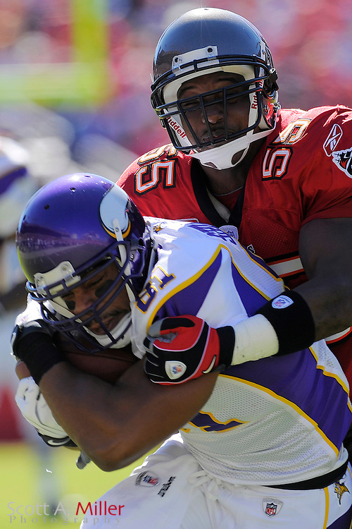 Nov. 16, 2008; Tampa, FL, USA; Tampa Bay Buccaneers linebacker Derrick Brooks (55) tackles Minnesota Vikings tight end Visanthe Shiancoe (81) during their game at Raymond James Stadium. The Bucs won 19-13. ...©2008 Scott A. Miller