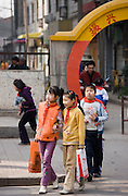 Children leave the playground of a primary school in Hong Ying Road, Xian. China has a one child policy to limit population.