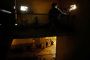 An Iraqi Army Soldier takes a shower while A U.S. Army Soldier of Company provides security during combat operations  OCT. 4, 2007 Balure, Iraq.