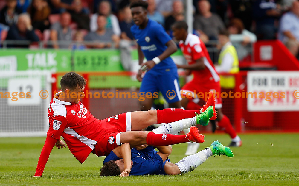 Ruben Sammut is challenged by Mark Randall of Crawley during the pre season friendly between Crawley Town and Chelsea XI at the Checkatrade Stadium in Crawley. 15 Jul 2017