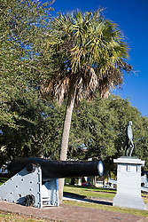 Artillery cannon, palmetto tree, and statue in White Point Gardens, Charleston, South Carolina, United States of America.