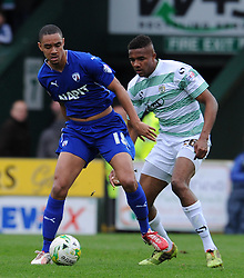 Chesterfield's Byron Harrison is tackled by Yeovil Town's Stephen Arthurworrey - Photo mandatory by-line: Harry Trump/JMP - Mobile: 07966 386802 - 03/04/15 - SPORT - FOOTBALL - Sky Bet League One - Yeovil Town v Chesterfield - Huish Park, Yeovil, England.