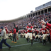 Harvard celebrate victory at the end of the game during the Harvard Vs Yale, College Football, Ivy League deciding game, Harvard Stadium, Boston, Massachusetts, USA. 22nd November 2014. Photo Tim Clayton