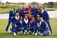 The European team celebrate winning<br /> <br /> Sunday singles The victorious European Team after beating USA with the trophy after the winning presentation<br />