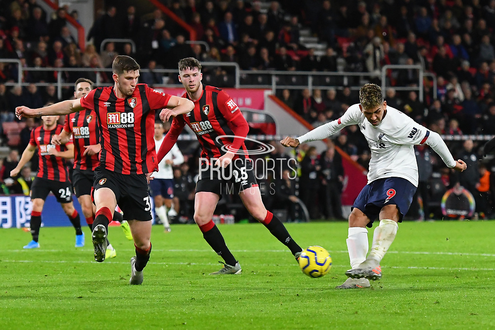 Roberto Firmino (9) of Liverpool shoots at goal during the Premier League match between Bournemouth and Liverpool at the Vitality Stadium, Bournemouth, England on 7 December 2019.