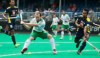 ANTWERP -    Peter Caruth (l) scores 2-0 during  the hockeymatch for the 5th place between Ireland an d Malaysia.   WSP COPYRIGHT KOEN SUYK