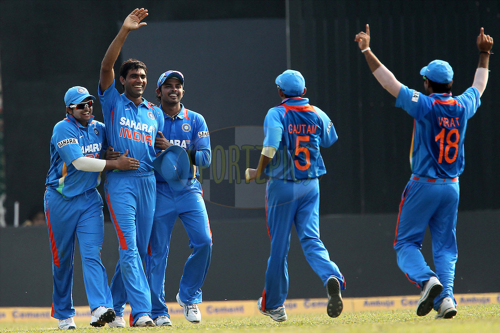 India celebrate the wicket of Martin Guptill of New Zealand during the 1st ODI (One Day International ) between India and New Zealand held at the Nehru Cricket Stadium in Guwahati, Assam, India on the 28th  November 2010..Photo by Ron Gaunt/BCCI/SPORTZPICS
