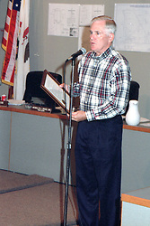 July 1, 2001 - Paul Harmon gives out the Harmon Arts Awards at a Normal Town Council meeting.<br /> <br /> <br /> This image was scanned from a slide, print, negative or transparency.  Image quality may vary.  Dust and other unwanted artifacts may exist.