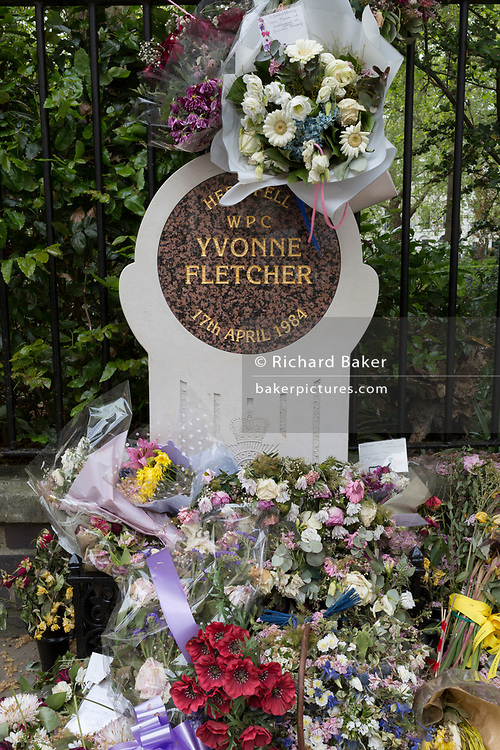 The memorial to WPC Yvonne Fletcher in St. James's Square, on 29th April 2019, in London, England. WPC Yvonne Fletcher, a Metropolitan Police officer, was shot and killed by an unknown gunman on 17 April 1984, during a protest outside the Libyan embassy on St James's Square, London. Her death resulted in an eleven-day siege of the embassy, at the end of which those inside were expelled from the country and the United Kingdom severed diplomatic relations with Libya.
