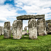 Stonehenge Southwest Face. Believed to have been built somewhere between 2000 and 3000 BC, Stonehenge is one of the United Kingdom's most distinctive landmarks and a major tourist draw. It's function and purpose remains a matter of conjecture, although many theories have been offered. It consists of a series of large standing stones, some of which have toppled over the centuries. Stonehenge is located in Salisbury Plain west of London.